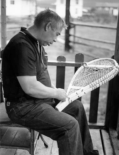 Damien Benoit of Conne River constructing a pair of snowshoes.