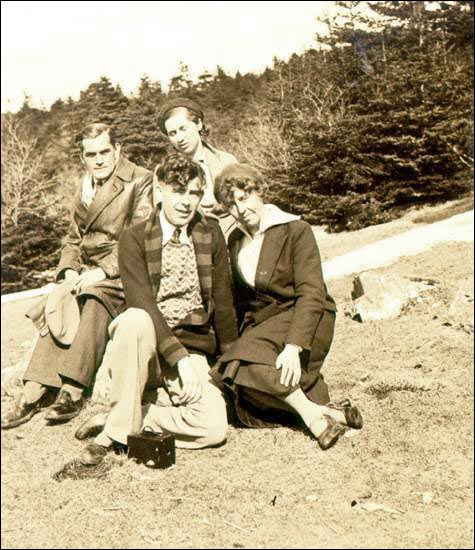 Edwin Duder and Florence Miller (back row, left) pose with two unidentified friends probably at Topsail. If readers can identify the two friends, contact Bert Riggs, 864-4074.