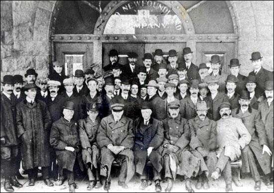 Employees of the Reid Newfoundland Company outside the Riverhead Station, St. John's. William and Harry Reid are sitting in the centre of the first row.