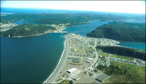This aerial view of Placentia shows a community built on a beach-ridge complex, very close to sea- level.