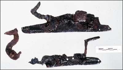 """Top half of image: Lock from a 17th-century """"snaphaunce,"""" so called because its action resembled the pecking of a chicken. First half of the 17th century. Lower half of image: An English """"dog lock,"""" so called because a small dog, or catch, held the cock in place and prevented the musket from discharging accidentally."""
