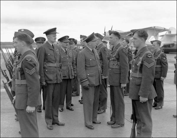 Air Vice-Marshal A. Earl Godfrey inspects RCAF personnel stationed at Botwood, September 1943.