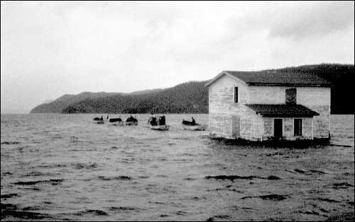 Under the Resettlement Program the sum of $1,000 was paid to the head of each household to help defray the cost of moving the dwelling and other buildings. To view other images visit the Maritime History Archive's  Moving House section of their Resettlement site.
