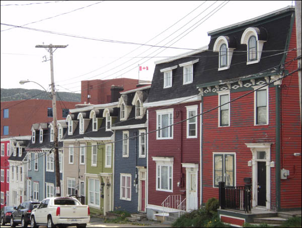 This view of homes on Cochrane Street shows how many of the houses built after the Great Fire of 1892 were in the Southcott or Second Empire style. The mansard roof and hooded dormer windows are clearly evident in this row of houses.