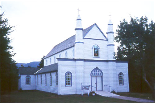 The Precious Blood Roman Catholic Church and Bell House is an excellent example of the Romanesque style of architecture employed in a rural  setting.